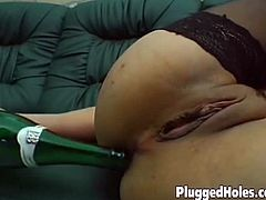 Nasty milf goes extreme she misses her gifted hubby so much that she tried to pleasure herself with a wine bottle and a cucumber inserting it on both of her wet holes.