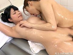 Take a look at this great lesbian scene where these sexy Japanese babes have a great time pleasing each other inside a water filled tub.