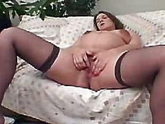 Pregnant babe stroking her pussy