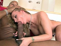 Lewd blonde milf Aline admires a black stud with her cock-sucking skills. Then they have sex in the cowgirl and the missionary positions.