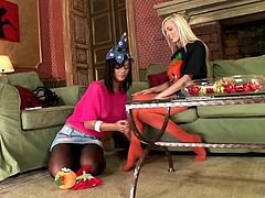Pretty chicks Black Angelica and Szofya Cox, wearing pantyhoses, are getting naughty indoors. They caress each other tenderly, then suck each other's toes and enjoy it a lot.
