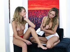A sizzling lesbian pornstar with long blonde hair, petite natural tits and a hot body enjoys getting her wet pussy fingered.