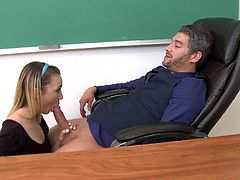 Masturbate as you watch this blonde coed, with small tits wearing stockings, while she gets drilled hard doggystyle in a college classroom.