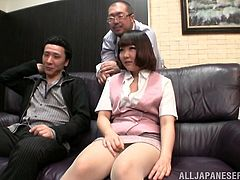Have fun watching this Japanese doll, with natural breasts wearing nylon pantyhose, while she gets masturbated by two horny fellows.