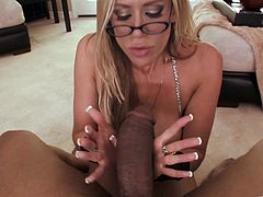 Bootylicious light-haired goddess with juicy booty stands on her knees in front of black dude and provides him with awesome blowjob until getting facialed.