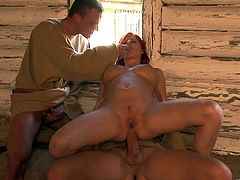 While out in the cabin this redhead takes on two guys. She sucks and fucks them both before getting double penetrated by them.