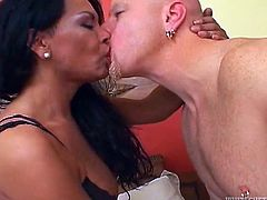 Big-assed brunette tranny Flelucia gives a blowjob to Tom Moore and lets him suck her weiner. After that she stands on all fours and they have some dirty doggy style banging.