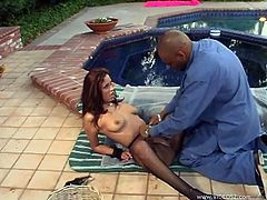 Make sure you see this! A brunette cougar, with big tits wearing a maid uniform, while she goes hardcore with a black dude outdoors.