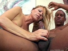 Zesty light-haired wench with big natural boobs has mutual oral sex with black bastard and gets doggyfucked. Then she rides BBC on top before getting plowed in a sideways and missionary positions.