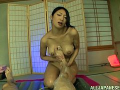 Big-breasted Japanese tart soaps her amazing big boobs and shows them to a guy. Then she gives him a handjob and a titjob and seems to enjoy herself.
