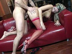 Horny long haired sweetie in red fishnets rides and blows sweet cock of her guy