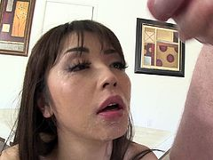 After playing with her vibrator, she gets a real cock to give a blowjob. She licks the balls and swallows the huge cock hardcore and gets a facial cumshot.