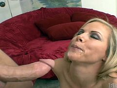 A pretty blonde cougar with long hair, big beautiful tits and a fantastic ass enjoys a hardcore doggy style fuck on her couch.