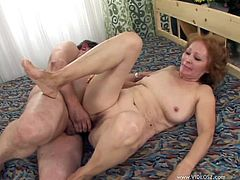 Witness this reality video where a granny redhead, with natural jugs and a shaved pussy, gets banged hard and moans like a wild animal.