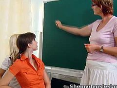 Marisa and a schoolmate of hers have some lesbian fun with their older teacher. First, they lick each other, but then they both fuck the teacher's hairy pussy.