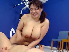 Get a hard dick by watching this chubby Asian, with big natural knockers wearing a sexy top, while she gets pounded hard in the gym.