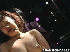 This delicate Japanese slave is bound with rope by her stunning mistress. She gets ass toyed and whipped before other two sexy mistresses come to her and caress her.