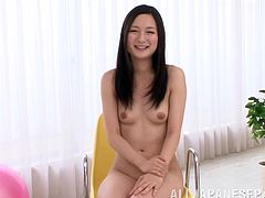 A beautiful Asian girl with long hair, petite tits a
