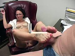 The gorgeous brunette Veronica Jett shows her perfect ass in the office and gives this lucky guy an amazingly sexy footjob.