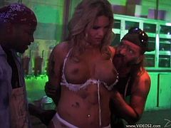 Bosomy light-haired skank kneels down and gives hell of blowjob to horny bikers. Thereafter she gets her soaking poontang hammered mish and doggystyle.