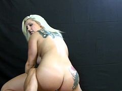 Blonde with big tits and tattoo on butt cheek gives blowjob on the couch and get a pussy licking in randy oral sex session