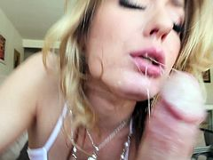 A sizzling blonde babe with long hair, huge tits and a hot ass enjoys licking a stranger's big balls in her living room.