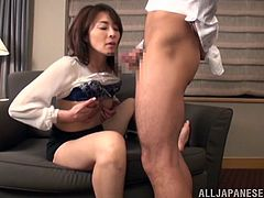 Have a good time watching this Asian cougar, with natural breasts wearing a miniskirt, while she uses her mouth smartly to satisfy a man.