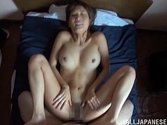 Get a hard dick by watching this Japanese babe, with a nice ass wearing a bikini, while she gets banged hard in the missionary position.