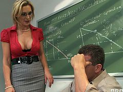 A beautiful blonde teacher with long hair, big gorgeous tits and a shaved pussy enjoys a hardcore doggy style fuck in a classroom.
