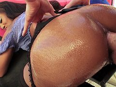 Hypnotizing ebony with big black butt gets her shaved pussy licked before getting her anal hole oiled and hammered doggystyle.