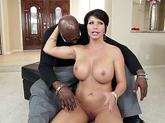 Check this short haired cougar, with titanic love pillows and a shaved cunt, while she talks about sex with a giant black cock next to her.