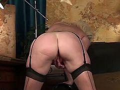 Naughty blonde in military uniform is a certified milf. Besides fucking young guys she love getting alone in her office and stripping off her clothes fingering her fine pussy.