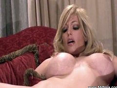 She must have like her new dildo. This blonde Milf with huge titties just bought it two days before because she was not satisfied with her fingers. And the results are great evidently the wet pussy.