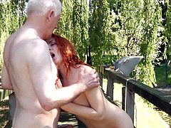 Red-haired college student fucks with her old teacher outside