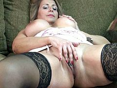 Chubby mature slut in black stockings loves playing with her pussy