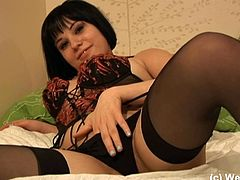 Doral Dolce rolls around on her bed in some very sexy lingerie and thigh high stockings while teasing her tender, wet pussy.