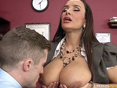 Lisa is a very sexy MILF with amazing large breasts who wants to get her boss attention. She gets inside his office and unbuttons her shirt in front of him. Seeing her large sexy boobs he can't focus on anything else except her. He touches her breasts and licks them. Lisa gets on her knees while he fucks her tits.