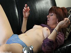 Horny hottie fingers herself while having a smoke in amateur solo clip