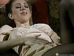 Beauty caresses her bawdy cleft beneath hose