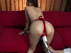 Slim Japanese chick Rina Rukawa, wearing panties and a bra, gets tied up by a guy indoors. The man fingers Rina's coochie, then rubs it with a massage dildo.