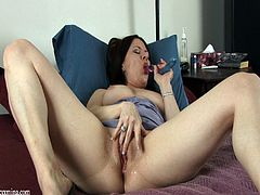Watch the horny milf Mina Gorey playing with her pink shaved pussy in this solo scene where you'll get an instant boner.