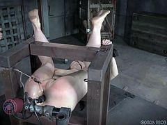 It's a hard time for her ass! This whore thought things will be easy for her here at Real Time bondage but she found out the hard way that nobody feels like fooling around in this place. Now she's secured in a simple wooden bondage device, mouth gagged and ass fucked with a big dildo and pussy tortured.