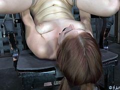 The young girl is scared. Brunette mistress bounded her on that chair to make sexual experiments on her. How mean she slapping that bounded pussy, no wonder the girl is scared. But when she put the vibrator on the clit, redhead girl getting horny fast. Her clit is on fire. Now brunette can pump that pussy and tits. You thin they have a secure word?