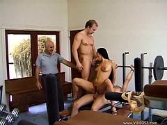 This horny brunette wife gets her pussy absolutely drilled by two hung dudes and ends up getting a nasty cumshot while her cuckold husband watches.