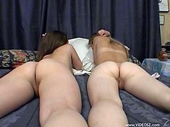 Amazing gaping lesbians with hot ass undresses before licking each other pussies and displaying their small lips pussies on a cozy bed