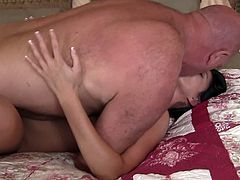 Prepare your cock for this long haired brunette, with a shaved pussy and big love pillows, while she gets nailed hard and swallows this guy's jizz.
