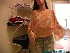 Hot brunette Sheri Mills is getting naughty indoors. She shows her shaved pussy close up for the cam, then masturbates it with a dildo.