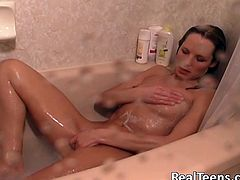 Have fun jerking off to this hot solo scene as you watch this sexy blonde taking a bath and playing with herself.