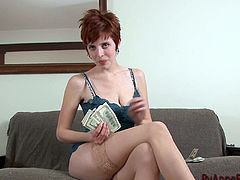 Short-haired milf Ryanne Redd, wearing a bra, is gonna earn some money. The woman strips and demonstrates her big natural breasts and gets some cash for it.