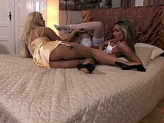 Blonde and brunette sluts play sexy feet games